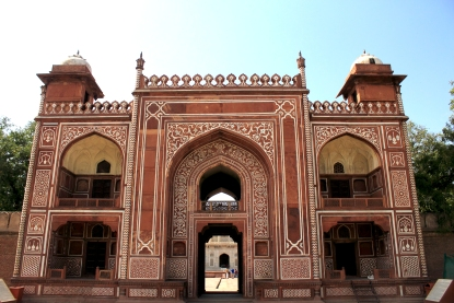 The painted entrance gate of the tomb of Itimad ud Daula in red sandstone