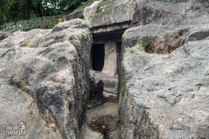 Narrow rock cut path to cave 2