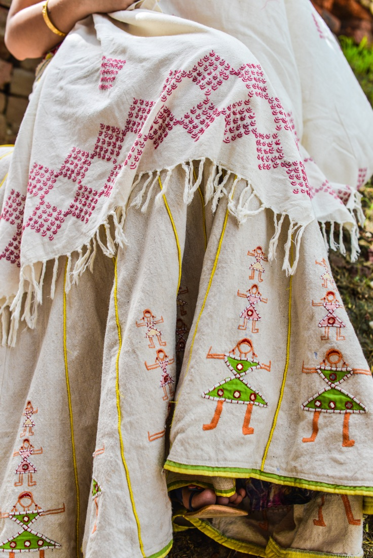 Apparel designed by Lalita and hand crafted in embroidery by a woman of Bohar village -on Reza