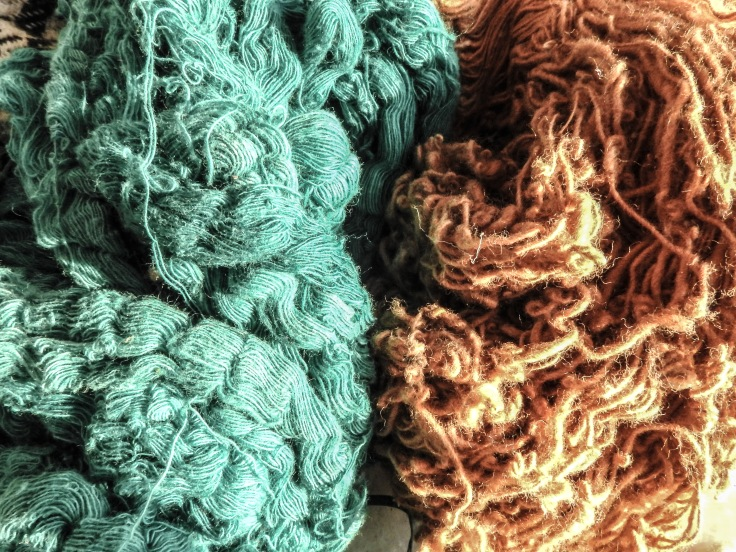 Hand supn cotton yarn -dyed in organic azure blue earth color (left) and yarn spun with natural brown cotton