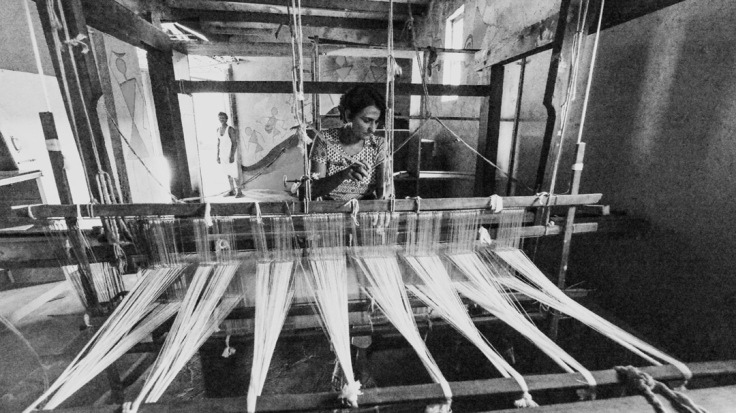 Lalita at her six pedal loom