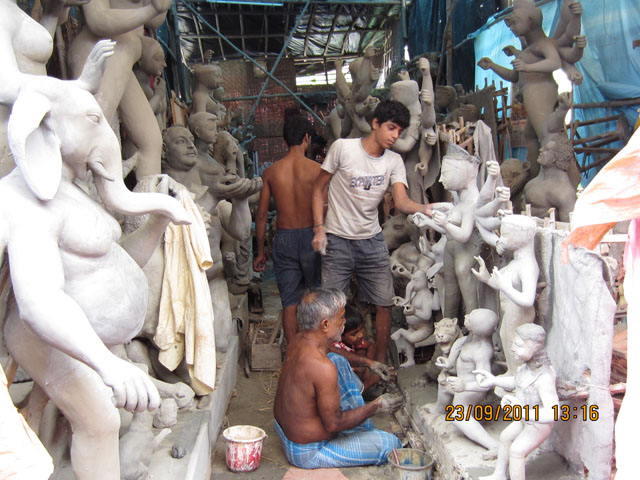 Artists At work within the narrow lanes of Kumartuli
