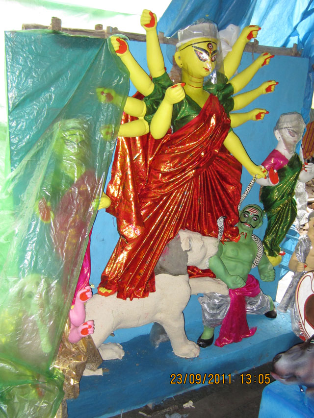 The deity is often decked in a red saree